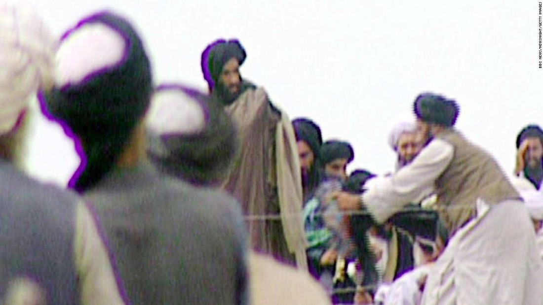 In this image taken off television by BBC Newsnight, Omar -- fourth from left -- attends a rally with Taliban troops before their victorious assault on Afghanistan's capital, Kabul, in 1996. The Taliban's aim is to impose its interpretation of Islamic law on Afghanistan and remove foreign influence from the country. Most of its members are Pashtun, the largest ethnic group in Afghanistan.