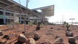 Endemic plants are dotted around the entrance of the 6,000m building, which required a $40m investment and was built using sustainable construction.