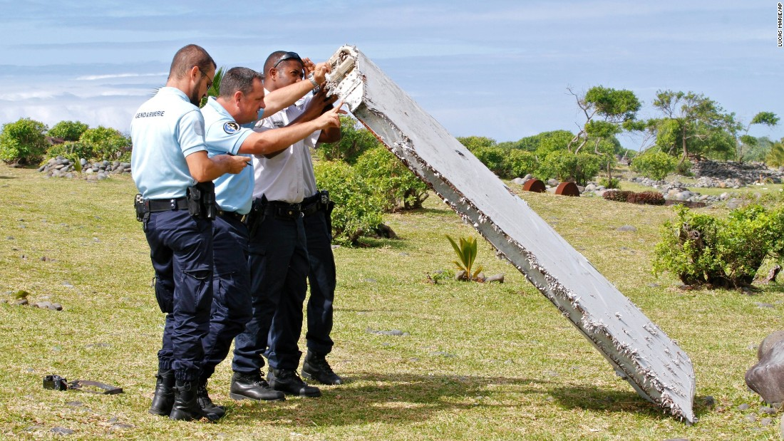 Police officers inspect debris on July 29.