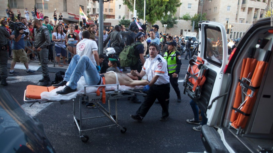 A victim receives treatment after the stabbing.