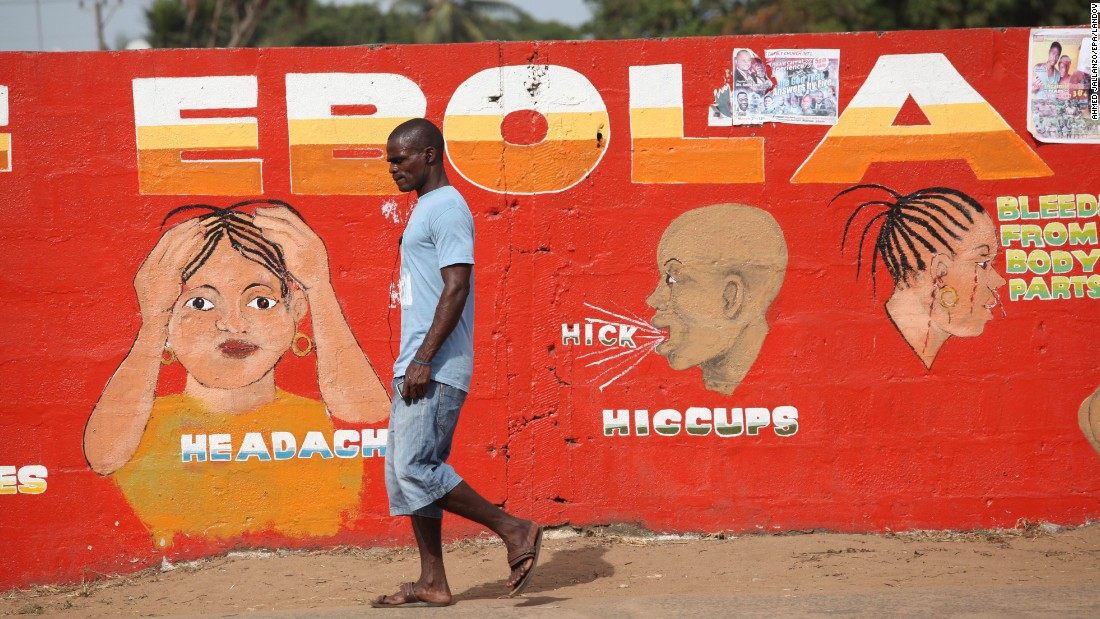 A man walks past an Ebola awareness painting in Monrovia on March 22.