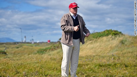Republican Presidential Candidate Donald Trump drives a golf buggy during his visits to his Scottish golf course Turnberry on July 30, 2015 in Ayr, Scotland.
