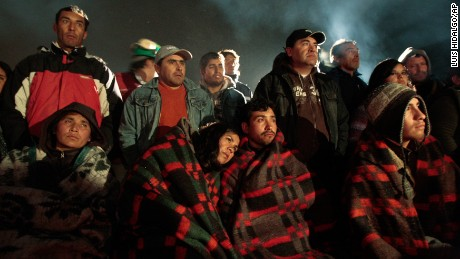 Relatives wait as rescuers scramble to dig out 34 copper workers trapped inside the San Jose mine in Copiapo, northern Chile, Friday, Aug. 6, 2010. Miners are  trapped  nearly 1,000 feet (300 meters) below ground after a tunnel caved in. (AP Photo/Luis Hidalgo)