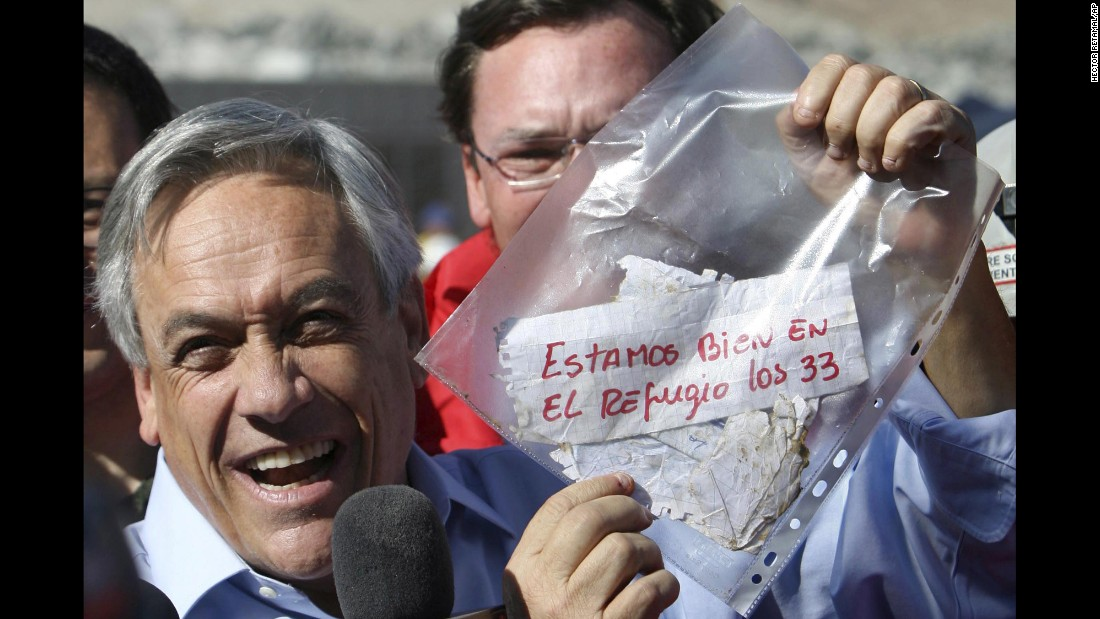 "Chilean President Sebastian Pinera holds up a plastic bag containing a message from the miners on August 22. Translated from Spanish, it read: ""We are OK in the refuge, the 33."" The miners were confirmed to be alive when rescue teams reached them via a tube that was sent down a small hole. The same hole was used to provide the miners with food, supplies and letters."