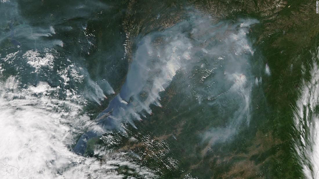 Smoke from fires near the shoreline of Russia's Lake Baikal was captured by NASA's Aqua satellite on July 27. The red spots show where fires were most active. Lake Baikal is the largest freshwater lake by volume in the world, but its water levels have dropped in recent months, according to the Reuters news agency.