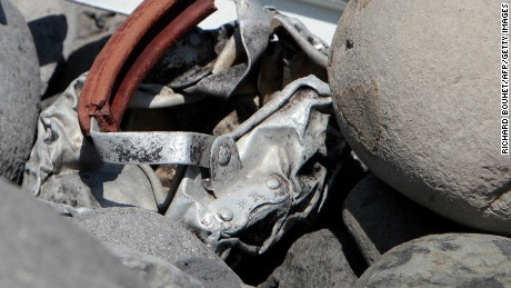 Caption:This picture taken on August 2, 2015 shows metallic debris found on a beach in Saint-Denis on the French Reunion Island in the Indian Ocean, close to where where a Boeing 777 wing part believed to belong to missing flight MH370 washed up last week. A piece of metal was found on La Reunion island, where a Boeing 777 wing part believed to belong to missing flight MH370 washed up last week, said a source close to the investigation. Investigators on the Indian Ocean island took the debris into evidence as part of their probe into the fate of Malaysia Airlines flight MH370, however nothing indicated the piece of metal came from an airplane, the source said. AFP PHOTO / RICHARD BOUHET (Photo credit should read RICHARD BOUHET/AFP/Getty Images)