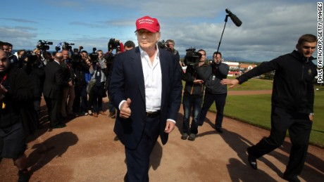US billionaire Donald Trump (C) is pictured as he arrives at the Women's British Open Golf Championships in Turnberry, Scotland, on July 30, 2015