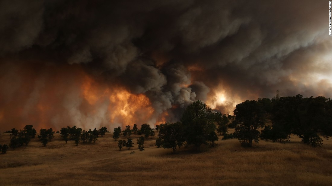 Large plumes of smoke rise from the Rocky Fire on Saturday, August 1.
