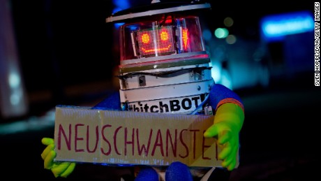 HitchBOT waits for a ride in Germany earlier this year. The robot didn't survive its attempted trip across the U.S.