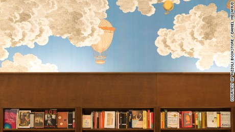 The new Rizzoli Bookstore features wallpaper exclusively designed by Fornasetti Milano.