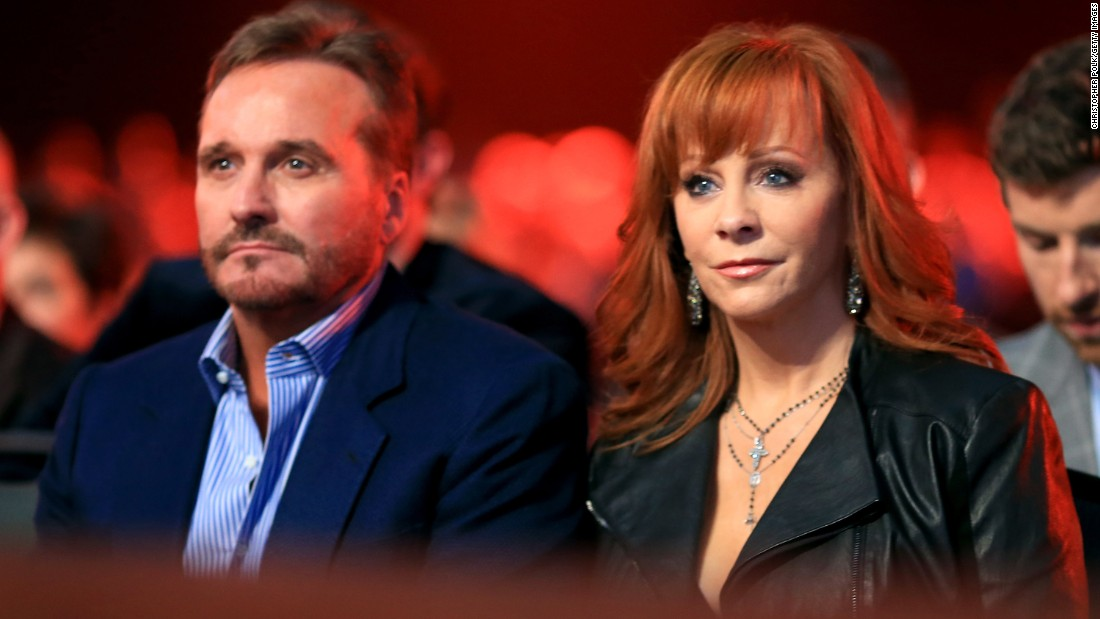 "After 26 years of marriage,<a href=""http://www.cnn.com/2015/08/03/entertainment/reba-mcentire-split/index.html""> Narvel Blackstock and Reba McEntire</a> divorced on October 28 after a separation of a few months, McEntire announced in late December. Though their marriage has ended, the couple will continue to work together. Blackstock is McEntire's manager."