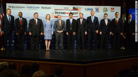 Caption:MANCHESTER, NH - AUGUST 3: (L-R) Former Florida Gov. Jeb Bush, Dr. Ben Carson, New Jersey Gov. Chris Christie, former CEO Hewlett-Packard Carly Fiorina, U.S. Senator Lindsey Graham (SC), Louisiana Gov. Bobby Jindal, Ohio Gov. John Kasich, former New York Gov. George Pataki, former Texas Gov. Rick Perry, former U.S. Senator Rick Santorum (PA), Wisconsin Gov. Scott Walker stand on the stage prior to the Voters First Presidential Forum for Republicans at Saint Anselm College August 3, 2015 in Manchester, New Hampshire. The forum was organized by the New Hampshire Union Leader and C-SPAN in response to the Fox News debate later this week that will limit the candidates to the top 10 Republicans based on nationwide polls. (Photo by Darren McCollester/Getty Images)