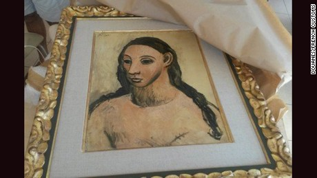 "French customs seize Picasso's Head of a Young Woman belonging to Spanish banking billionaire from yacht in Corsican port of Calvi on grounds it is a Spanish ""national treasure"" and not allowed out of the country."