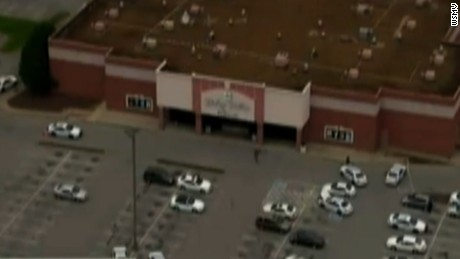 NS Slug: TN:THEATER SHOOTING-SCENE AERIALS  Synopsis: Man who opened fire in TN theater dead.  Video Shows: wide shot of theater, police officers walking around theater, more police cars, more officers walking around   Keywords: