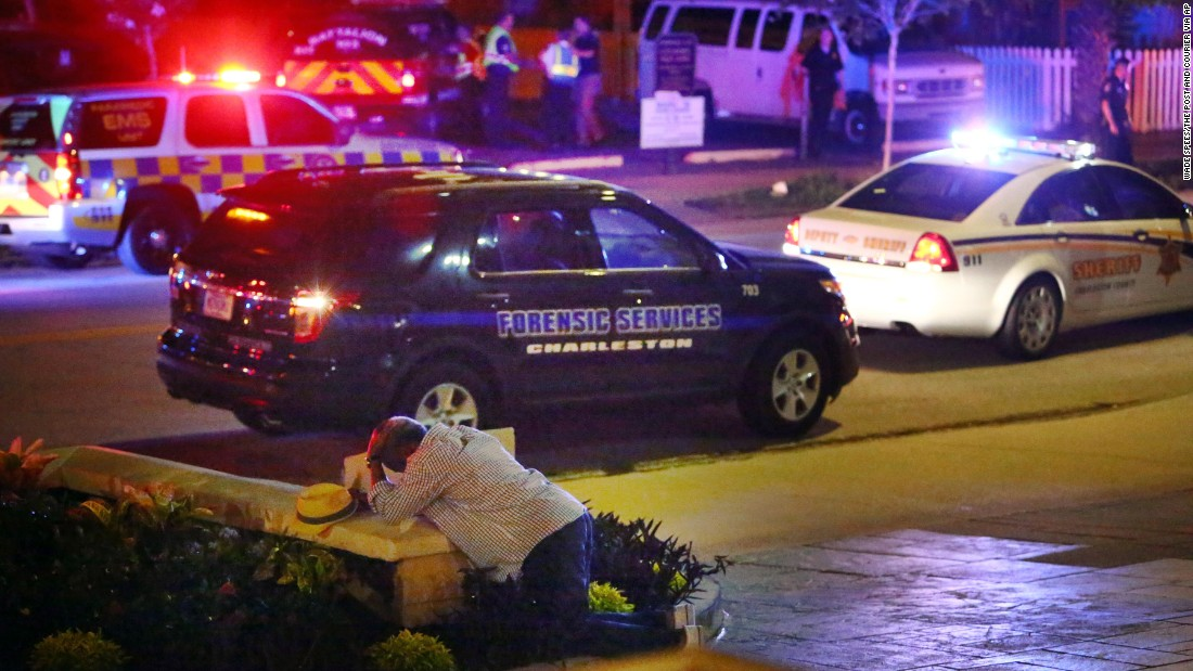 "A man kneels across the street from the historic Emanuel African Methodist Episcopal Church in Charleston, South Carolina, <a href=""http://www.cnn.com/2015/06/18/us/gallery/charleston-south-carolina-church-shooting/index.html"" target=""_blank"">following a shooting</a> on Wednesday, June 17. Police say the suspect, Dylann Roof, opened fire inside the church, killing nine people. According to police, Roof confessed and told investigators he wanted to start a race war. He <a href=""http://www.cnn.com/2015/07/31/us/dylann-roof-not-guilty-plea-charleston-church-shooting/"" target=""_blank"">pleaded not guilty</a> to 33 federal charges in July."