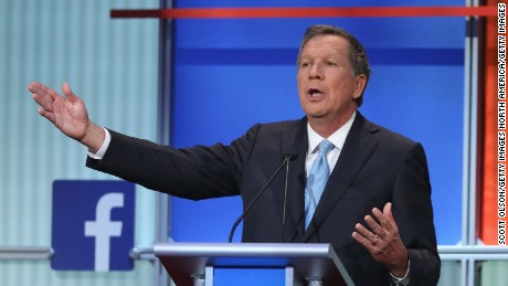 CLEVELAND, OH - AUGUST 06:  Republican presidential candidate Ohio Gov. John Kasich fields a question during the first Republican presidential debate hosted by Fox News and Facebook at the Quicken Loans Arena on August 6, 2015 in Cleveland, Ohio. The top ten GOP candidates were selected to participate in the debate based on their rank in an average of the five most recent political polls.  (Photo by Scott Olson/Getty Images)