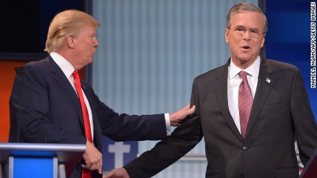 Real estate tycoon Donald Trump, left, and former Florida Gov. Jeb Bush interact during a commercial break of the prime-time Republican presidential debate. The debate was one of two in Cleveland on Thursday, August 6, hosted by Fox News.