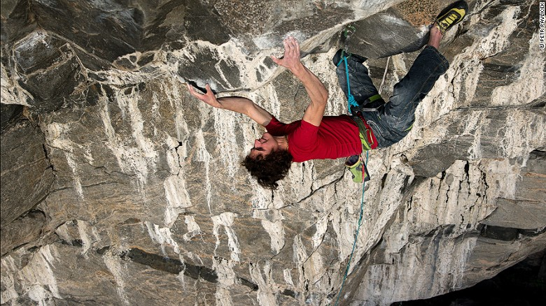 Adam Ondra climbs