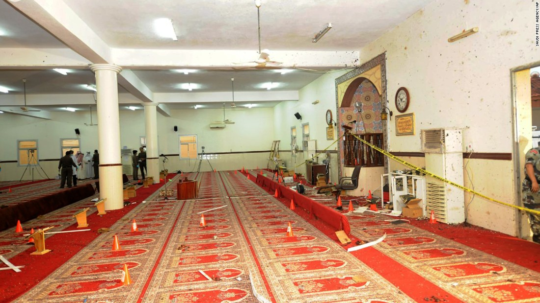 Saudi officials and investigators check a inside of a mosque on Aug 6.