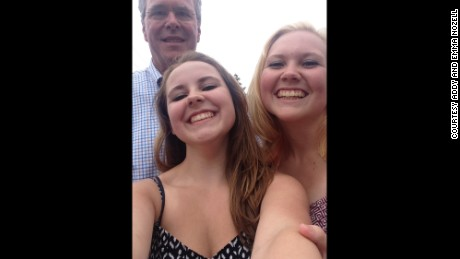 Emma and Addy Nozell with former Florida governor Jeb Bush on July 4 in Amherst, New Hampshire.