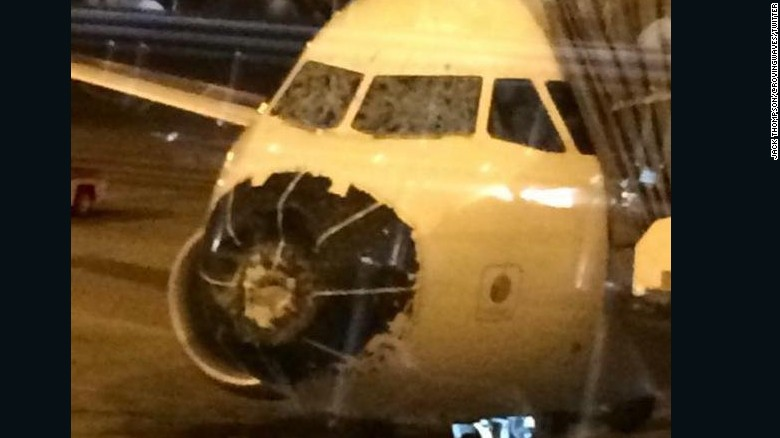 Hail cracks plane's windshields, forces emergency landing