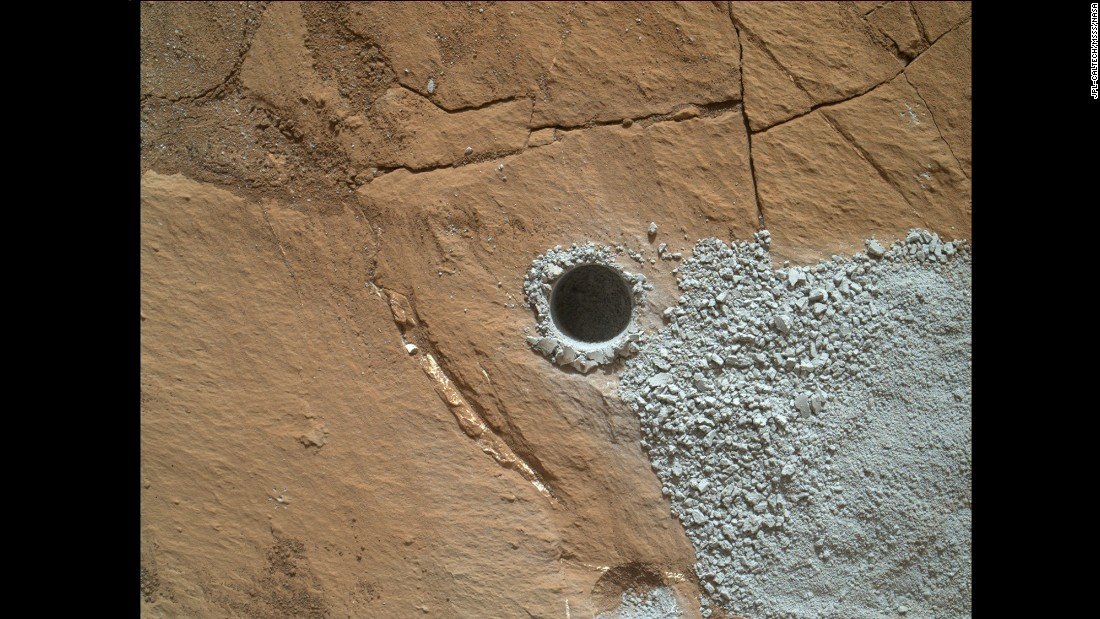 "The rover drilled this dime-sized hole to collect a sample from a rock called ""Buckskin"" on July 30."