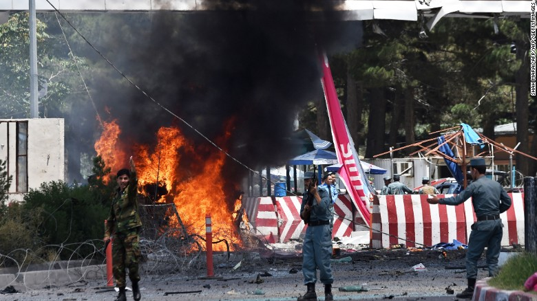 Afghan security forces keep watch at the site of a huge blast near the entrance of Kabul's international airport.