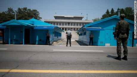 Sout Korean soldiers face the North korean side of the truce village of Panmunjom in the Demilitarized Zone (DMZ) between North and South Korea on May 14, 2014. Despite fears to the contrary, North Korea does not appear to be preparing an imminent nuclear test, a US think-tank said in an analysis of recent satellite images of Pyongyang's main test site. AFP PHOTO / Ed Jones        (Photo credit should read ED JONES/AFP/Getty Images)
