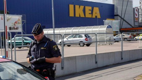 A police office talks to customers outside the Ikea store in Vasteras, Sweden, Monday Aug. 10, 2015, after three people were injured in a knife attack at the store. (Peter Kruger/TT via AP) SWEDEN OUT