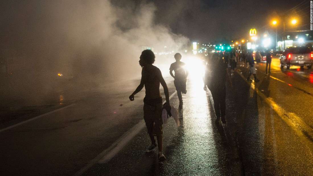 Demonstrators march along West Florissant Avenue in Ferguson on August 9. West Florissant is not far from Canfield Drive, where Brown was shot a year ago.
