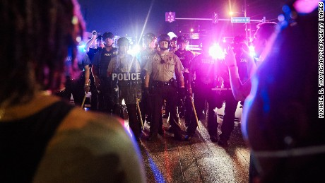 Police face off with protesters in Ferguson on August 9.