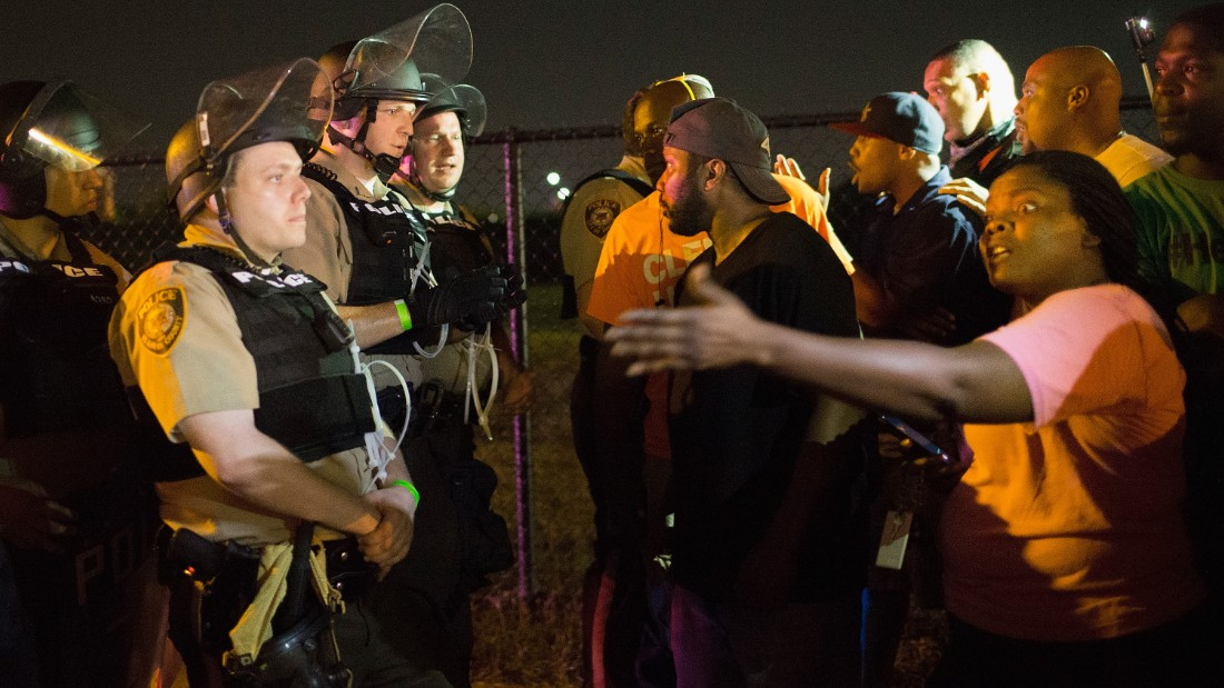 FERGUSON, MO - AUGUST 10:  Demonstrators, marking the one-year anniversary of the shooting of Michael Brown, confront police during a protest along West Florrisant Street on August 10, 2015 in Ferguson, Missouri. Mare than 100 people were arrested today during protests in Ferguson and the St. Louis area. Brown was shot and killed by a Ferguson police officer on August 9, 2014. His death sparked months of sometimes violent protests in Ferguson and drew nationwide focus on police treatment of black offenders.  (Photo by Scott Olson/Getty Images)