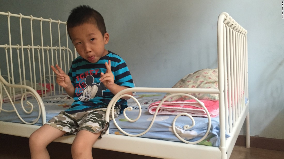 """Guang Quan is another resident of Alenah's Home. Christina Weaver, a Canadian missionary who works at the home, says of the children: """"They all deserve love. They don't deserve this kind of life."""""""