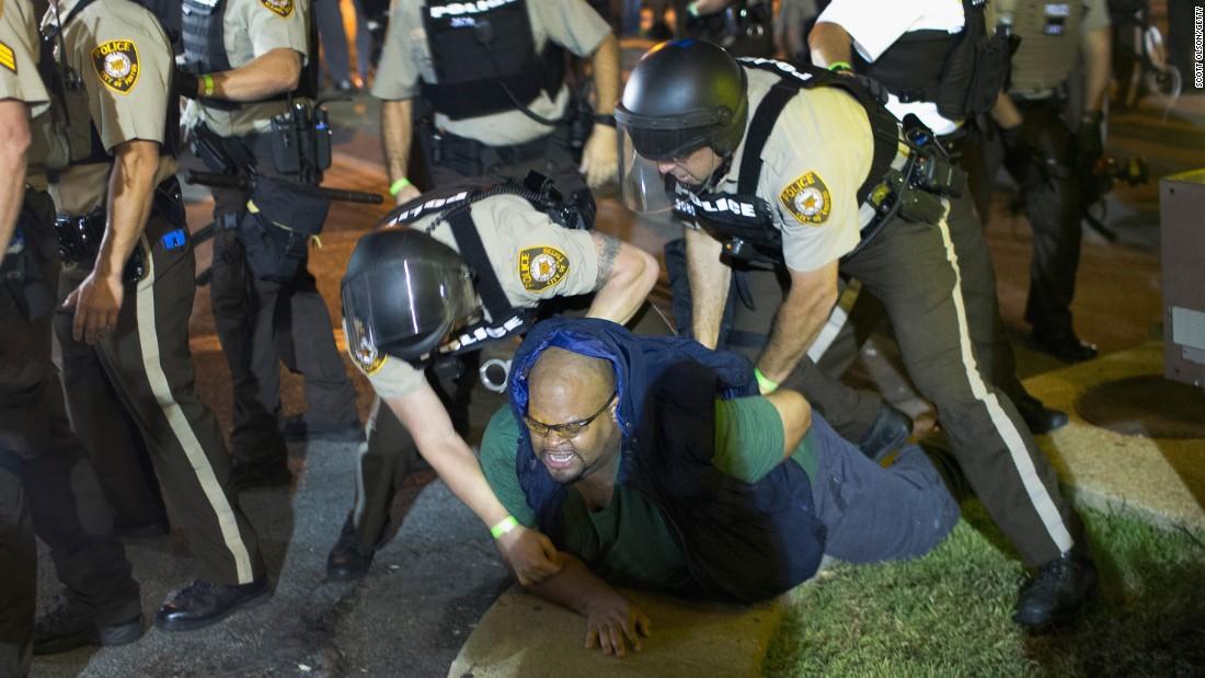 A demonstrator is arrested in Ferguson on August 10.