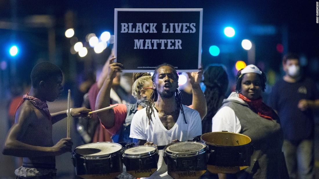 Demonstrators protest in Ferguson on August 10.