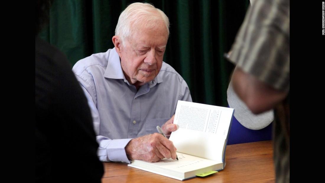 "Carter signs his book ""A Full Life: Reflections At Ninety"" in Pasadena, California, in July."