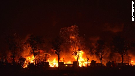 Flames and smoke rise from the site of a series of explosions in Tianjin early on August 13, 2015. A series of massive explosions at a warehouse in the northern Chinese port city of Tianjin killed 17 people, state media reported August 13, as witnesses described a fireball from the blasts ripping through the night sky.