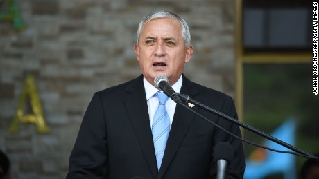 Guatemalan President Otto Perez Molina speaks during the swearing in ceremony of the new Defence Minister William Mancilla, in Guatemala City on August 14, 2015. The Guatemalan Congress rejected on Thursday to lift the president's immunity amid allegations of corruption. Guatemala has been in political upheaval since the UN commission started releasing findings on the customs fraud scheme, leading to the resignation of vice president Roxana Baldetti. Demonstrators have marched demanding Perez step down several times in recent months.