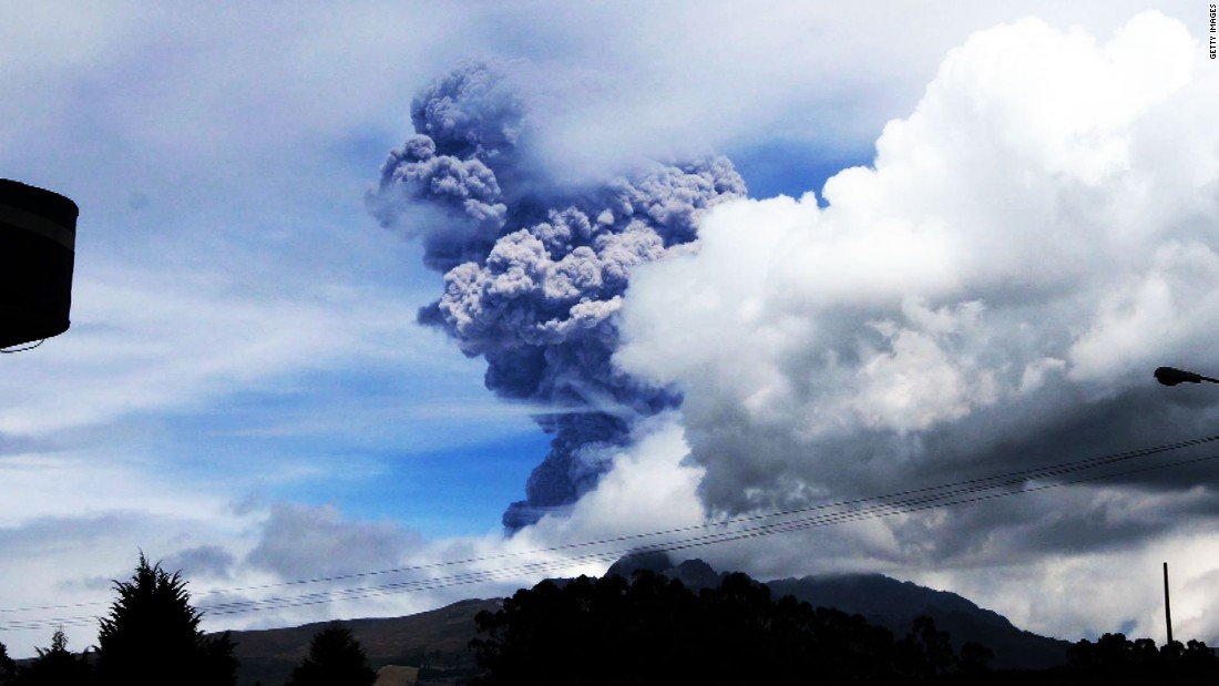 "Cotopaxi, a volcano in Ecuador, sends large gray puffs of ash into the sky on Friday, August 14. Officials <a href=""http://www.cnn.com/2015/08/15/americas/ecuador-japan-volcanoes/index.html"">declared a yellow alert</a>, the lowest level."
