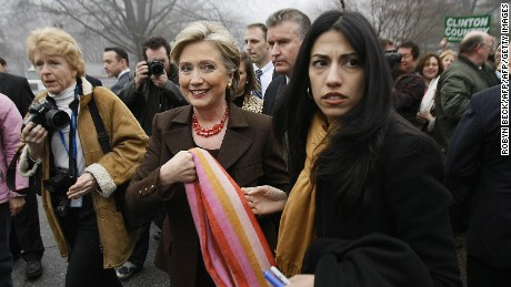Democratic presidential hopeful US Senator Hillary Clinton (D-NY) walks to her car after voting in the Democratic primary election, on February 5, 2008 in Chappaqua, New York.  At right is Huma Abedin, Clinton's traveling chief of staff. The latest polls show Democrats Hillary Clinton and Barack Obama neck-and-neck, while on the Republican side, Senator John McCain holds a comfortable lead over rival Mitt Romney, the former governor of Massachusetts.