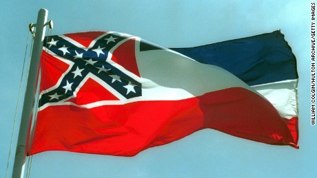 387975 02:  The Mississippi State flags flies April 17, 2001 in Pascagoula, MS. Voters will decide whether to replace the state's old flag, which sports the Confederate battle cross, with a new flag that would have 20 white stars on a blue square.  (Photo by Bill Colgin/Getty Images)