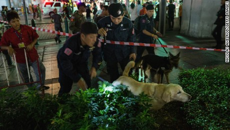 Police dogs search the scene of the explosion.