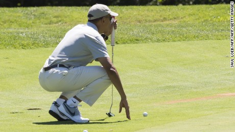 Obama lines up a putt as he plays golf at Farm Neck Golf Club in Oak Bluffs on Martha's Vineyard in Massachusetts, August 8, 2015.