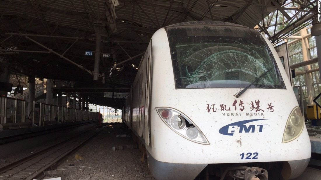 A train with a smashed-up windscreen sits abandoned in the eerily deserted station on August 17.
