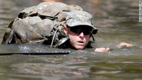 A female Army Ranger student crosses the Yellow River on a rope bridge on Tuesday, Aug. 4, 2015, at Camp James E. Rudder on Eglin Air Force Base, Fla. Two out of 19 females have made it to the final phase of Army Ranger training which ends at Camp James E. Rudder on Eglin Air Force Base. Pentagon leaders decided in 2013 to investigate the possibility  of opening all military jobs to women. (Nick Tomecek/Northwest Florida Daily News via AP)