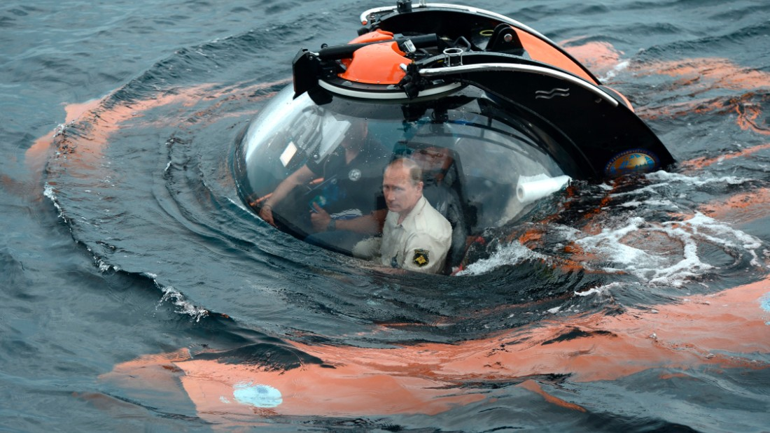 Russian President Vladimir Putin, centre, sits on board a bathyscaphe as it plunges into the Black sea along the coast of Sevastopol, Crimea, Tuesday, Aug. 18 President Vladimir Putin plunged into the Black Sea to see the wreckage of a sunk ancient merchant ship which was found in the end of May.