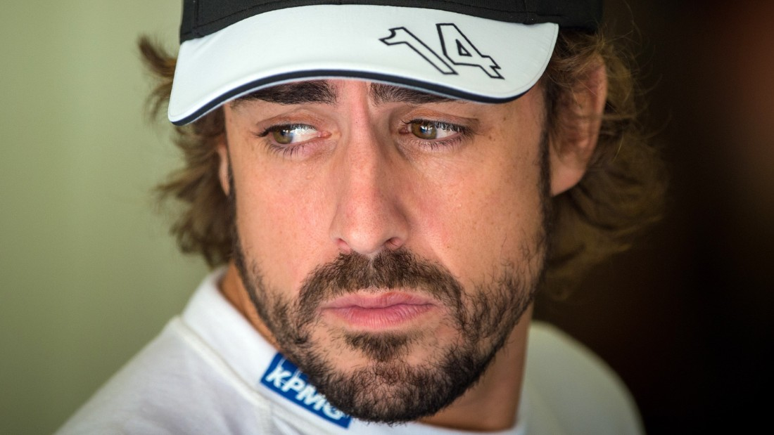 McLaren Honda's Spanish driver Fernando Alonso waits in the pits during the third practice session at the Hungaroring circuit  near Budapest on July 25, 2015, on the eve of the  Hungarian Formula One Grand Prix. AFP PHOTO / ANDREJ ISAKOVIC        (Photo credit should read ANDREJ ISAKOVIC/AFP/Getty Images)