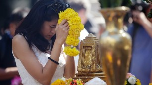 "A woman prays at the Erawan Shrine in Bangkok, Thailand, on Wednesday, August 19. Thai monks led prayers for the reopening of the Bangkok shrine where <a href=""http://www.cnn.com/2015/08/19/asia/thailand-bangkok-bombing/index.html"">a bomb killed 20 people</a> on Monday, August 17."