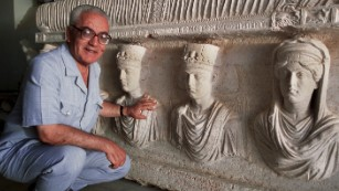 Khaled al-Asaad in front of a rare sarcophagus dating from the first century.