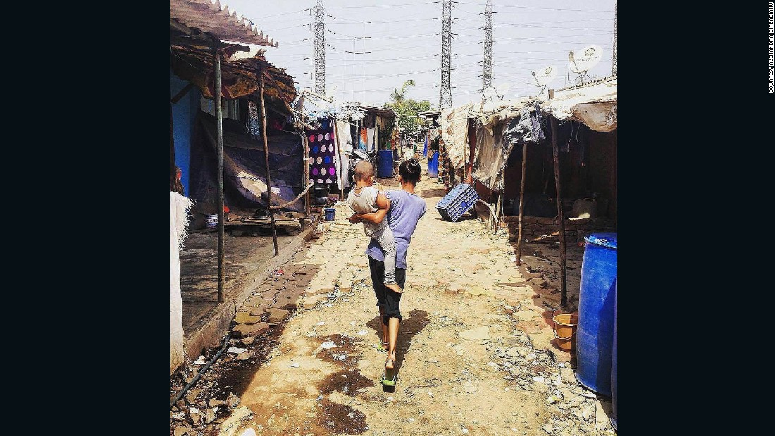 """""""We had to do an enormous amount of on the ground research to ensure that our features are aligned with the human experience of living in informal settlements,"""" said Gluckman. Pictured, a mother and child in Wadala settlement, Mumbai."""